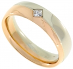 Male wedding ring made ​​of white and red gold with 0,11 crt diamond.