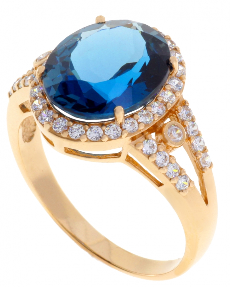 Gold female ring with zircons and topaz.