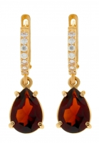 Gold earrings with garnet and zircon.