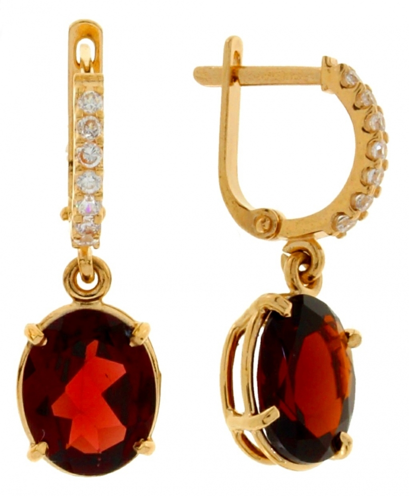 Gold earrings with garnet and zircons.