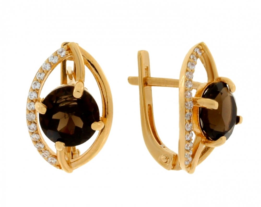 Gold earrings with smoky quartz and zircons.