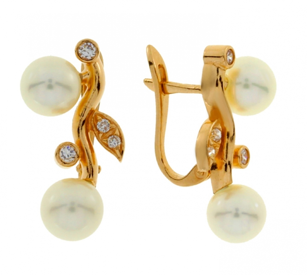 Gold earrings with pearls and zircons.